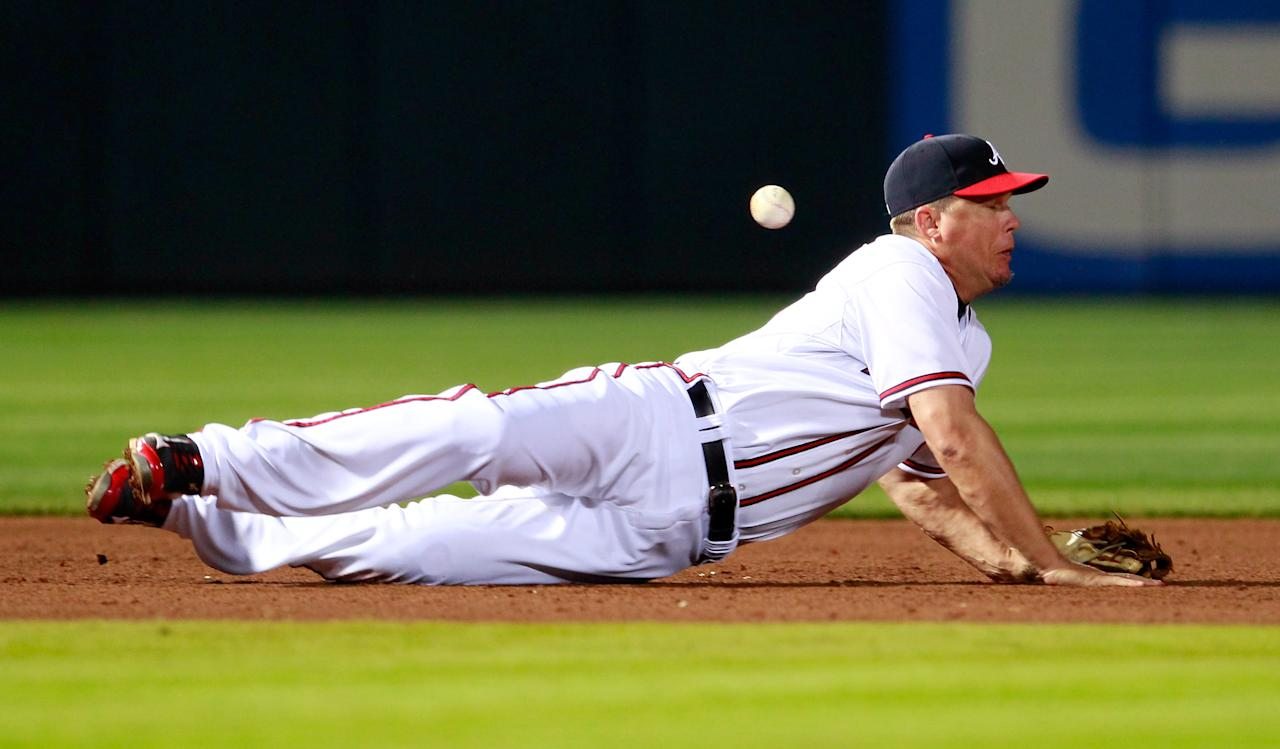 ATLANTA, GA - APRIL 17:  Chipper Jones #10 of the Atlanta Braves dives for a ground ball by Daniel Murphy #28 of the New York Mets in the sixth inning at Turner Field on April 17, 2012 in Atlanta, Georgia.  (Photo by Kevin C. Cox/Getty Images)