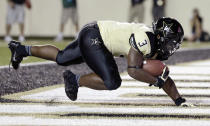 Vanderbilt running back Jerron Seymour falls into the end zone as he scores a touchdown on a 7-yard-run against UAB in the first quarter of an NCAA college football game on Saturday, Sept. 28, 2013, in Nashville, Tenn. (AP Photo/Mark Humphrey)