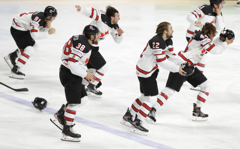 Canada's team players celebrate as they won the Ice Hockey World Championship final match between Finland and Canada at the Arena in Riga, Latvia, Sunday, June 6, 2021. (AP Photo/Sergei Grits)