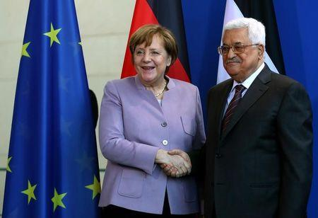 German Chancellor Merkel and Palestinian President Abbas shake hands after a statement in Berlin