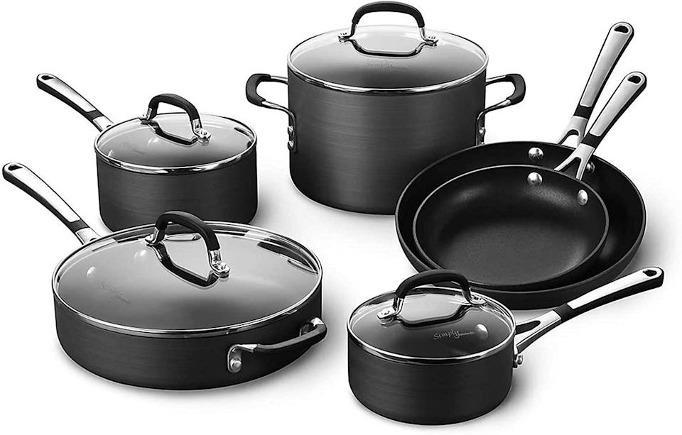"""With a whopping 2,000 reviews, you might just turn to this pot and pan set whenever you have to make a meal. It includes fry pans, sauce pans, a sauté pan and stock pot. The best part? These pots and pans havea two-layer nonstick coating on the inside for easy clean up.<a href=""""https://amzn.to/3j7jr6N"""" target=""""_blank"""" rel=""""noopener noreferrer"""">Originally $250, get the set now for $180 at Amazon</a>."""