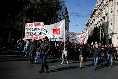 People take part in a demonstration marking a 24-hour general strike against austerity in Athens, Greece, December 14, 2017. REUTERS/Costas Baltas