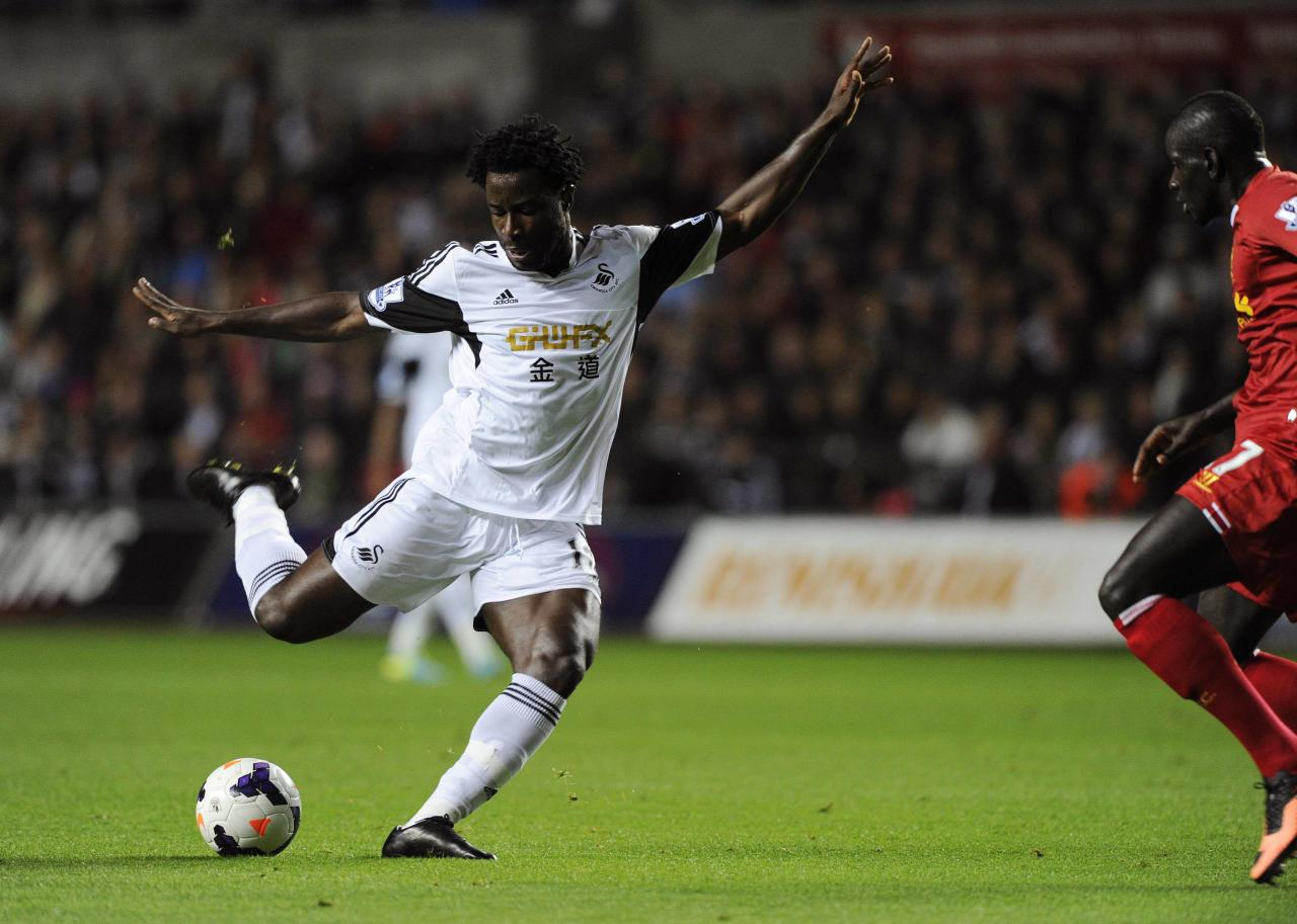 Swansea City's Bony shoots at goal during their English Premier League soccer match against Liverpool in Swansea