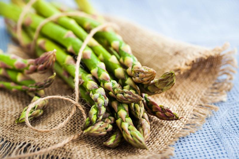 Raw fresh asparagus on rustic background, close-up