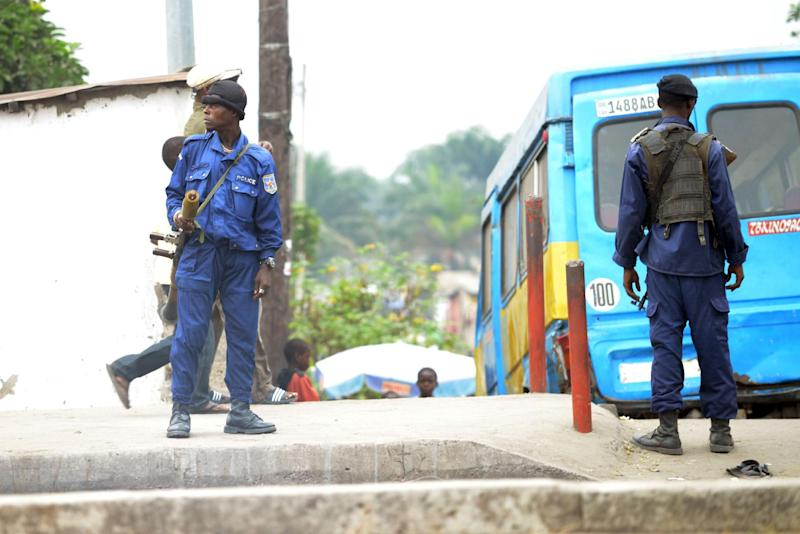 Congolese police stand guard in Kinshasa on July 2, 2013