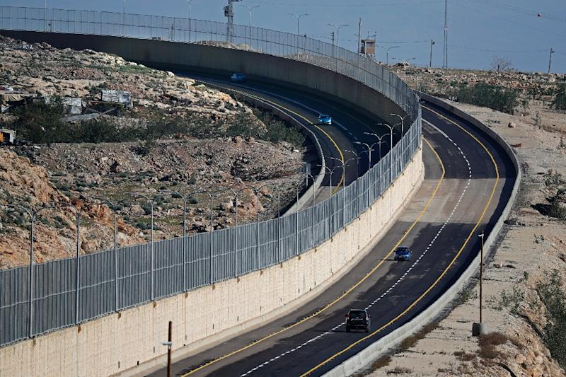 Cars drive along Route 4370 near Jerusalem on January 10, 2019 (AFP Photo/THOMAS COEX)