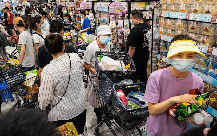 Panic buying in Wuhan after an outbreak of the delta variant - Getty