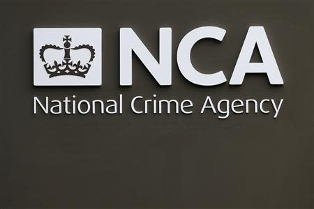 A sign is seen outside the National Crime Agency (NCA) headquarters in London October 7, 2013. REUTERS/Stefan Wermuth