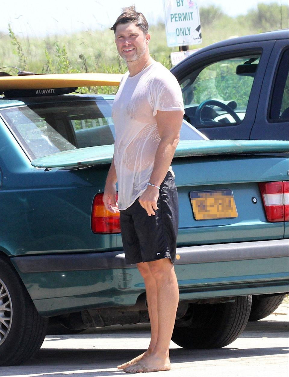 <p>Colin Jost gets ready to hit the road on Tuesday after surfing in The Hamptons, New York.</p>