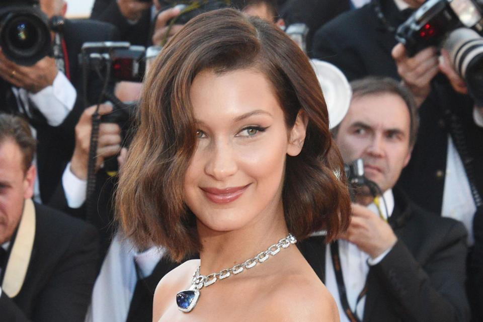 <p>To match her bouncy bob styled with Hollywood waves, Hadid's make-up was classic, with a perfect feline flick of liner.</p>