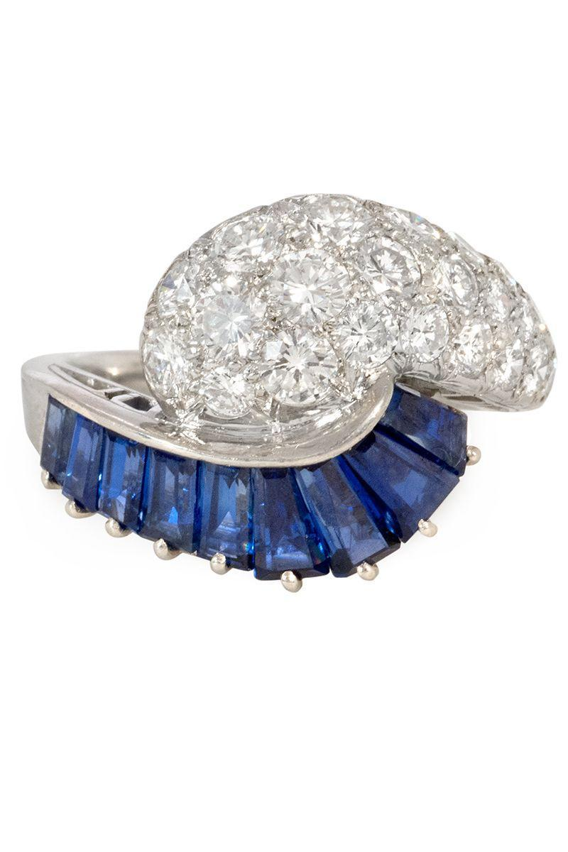 "<p><strong><em>Oscar Heyman </em></strong><em>Retro sapphire and diamond ring, circa 1945, $16,500, </em><a href=""https://www.kentshire.com/collections/fine-jewelry/products/retro-sapphire-and-diamond-ring-oscar-heyman-bros"" rel=""nofollow noopener"" target=""_blank"" data-ylk=""slk:kentshire.com"" class=""link rapid-noclick-resp""><em>kentshire.com</em></a></p><p><a class=""link rapid-noclick-resp"" href=""https://www.kentshire.com/collections/fine-jewelry/products/retro-sapphire-and-diamond-ring-oscar-heyman-bros"" rel=""nofollow noopener"" target=""_blank"" data-ylk=""slk:SHOP"">SHOP</a></p>"