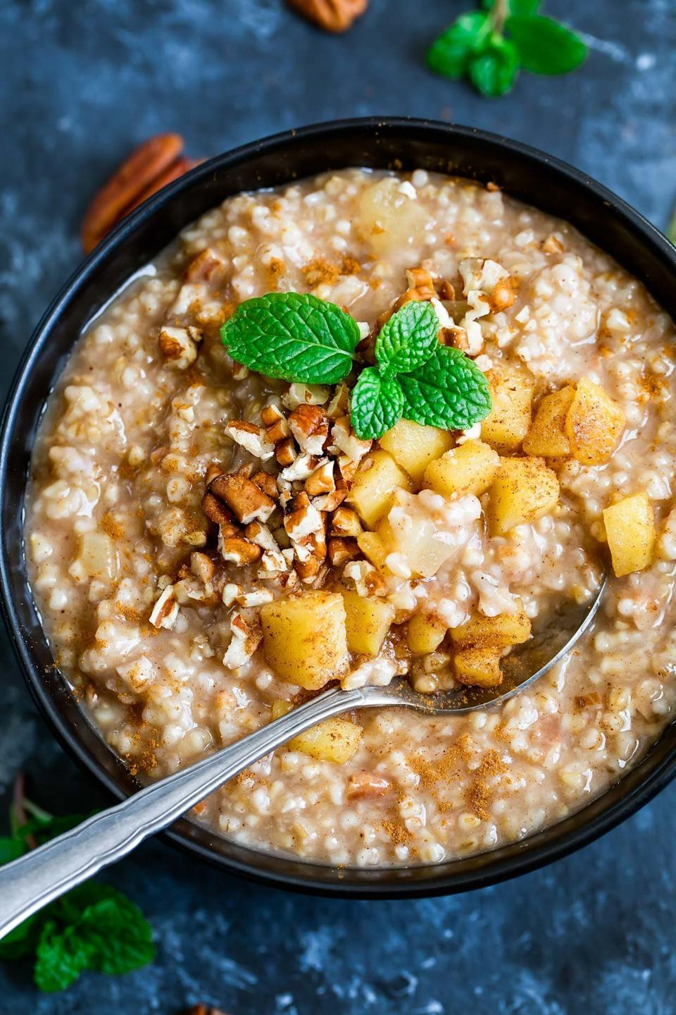 "<strong>Get the <a href=""https://peasandcrayons.com/2018/01/instant-pot-apple-cinnamon-oatmeal.html"" rel=""nofollow noopener"" target=""_blank"" data-ylk=""slk:Instant Pot Apple Cinnamon Oatmeal"" class=""link rapid-noclick-resp"">Instant Pot Apple Cinnamon Oatmeal</a> recipe from Peas and Crayons.</strong>"