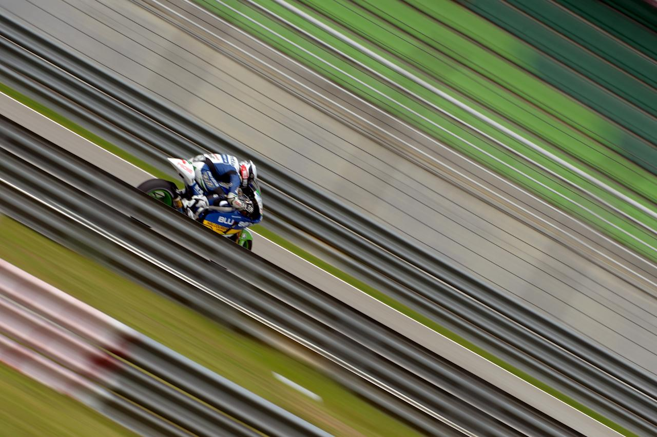 TOPSHOTS  BQR Team's Spanish Ivan Silva steers his bike during the first practice session of the Malaysian Grand Prix MotoGP motorcycling race at the Sepang circuit on October 19, 2012. AFP PHOTO / MOHD RASFANMOHD RASFAN/AFP/Getty Images
