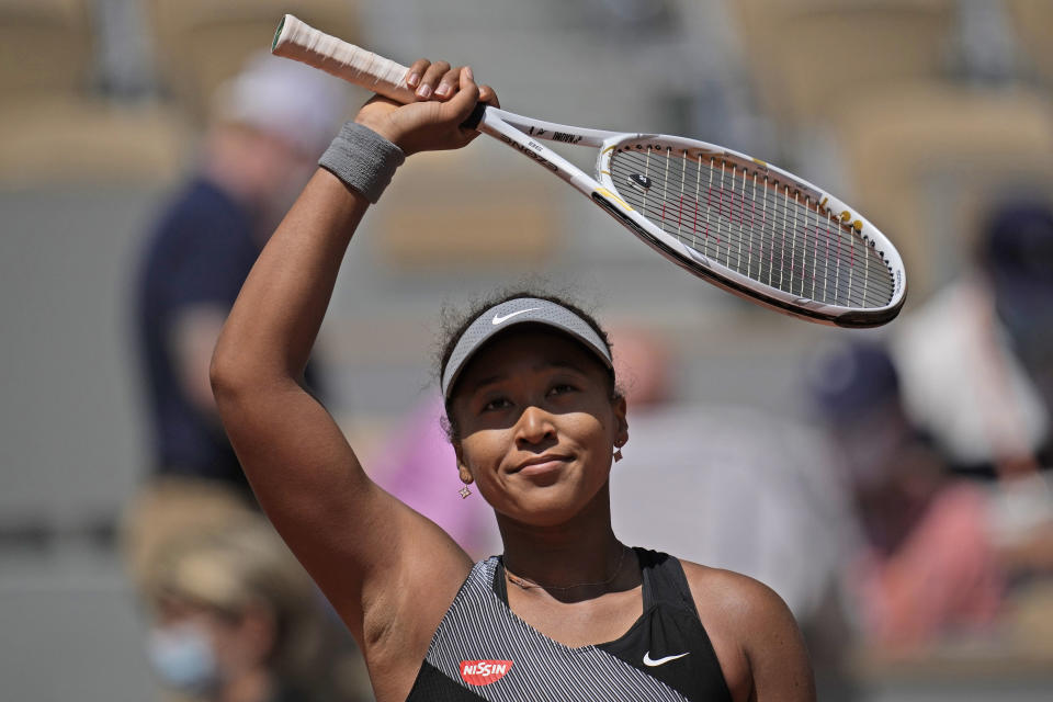 Japan's Naomi Osaka celebrates after defeating Romania's Patricia Maria Tig during their first round match of the French open tennis tournament at the Roland Garros stadium Sunday, May 30, 2021 in Paris. (AP Photo/Christophe Ena)