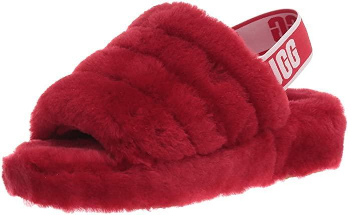 """<h3>Ugg Fluff Yeah Slide Slipper</h3><br>No cold feet here! Traipse around your apartment in ultimate comfort with these fan-favorite fluffy Ugg slippers in a Valentine's-appropriate ruby hue.<br><br><strong>Ugg</strong> Fluff Yeah Slide Slipper, $, available at <a href=""""https://amzn.to/3oJjj0F"""" rel=""""nofollow noopener"""" target=""""_blank"""" data-ylk=""""slk:Amazon"""" class=""""link rapid-noclick-resp"""">Amazon</a>"""