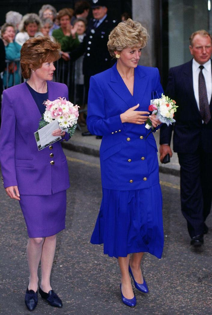 <p>Maybe monochrome runs in the family—both Princess Diana and her sister Sarah McCorquodale looked put together in blue and purple sets in 1992. </p>