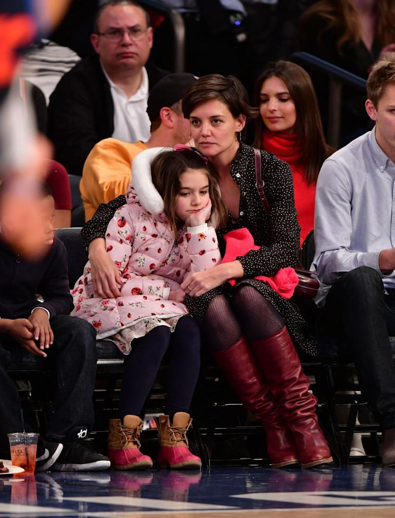 Suri Cruise and Katie Holmes attend the Oklahoma City Thunder Vs New York Knicks game at Madison Square Garden on December 16, 2017 in New York City.