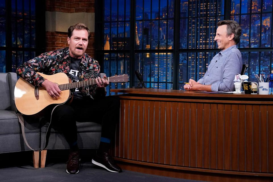 <p>Michael Shannon plays the guitar while guest starring on <i>Late Night with Seth Meyers </i>in N.Y.C. on August 26. </p>