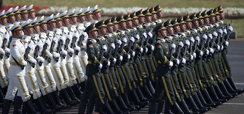 """Chinese President Xi Jinping has touted the need to build a """"world-class"""" army capable of """"defeating all invading enemies"""" (AFP Photo/AAMIR QURESHI)"""