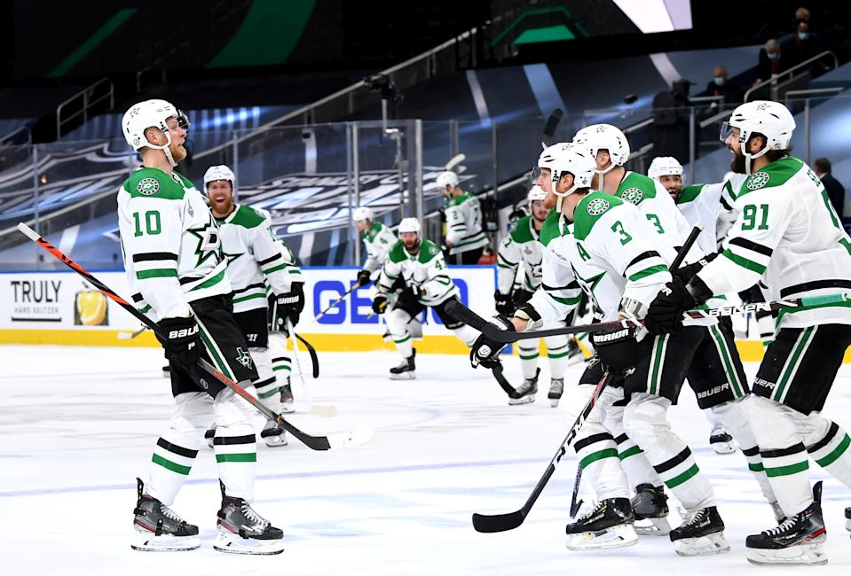 EDMONTON, ALBERTA - SEPTEMBER 26: Corey Perry #10 of the Dallas Stars celebrates with teammates after Perry scored the game-winning goal in the second overtime period of Game Five of the 2020 NHL Stanley Cup Final between the Dallas Stars and the Tampa Bay Lightning at Rogers Place on September 26, 2020 in Edmonton, Alberta, Canada. The Stars defeated the Lightning 3-2 in overtime.  (Photo by Andy Devlin/NHLI via Getty Images)