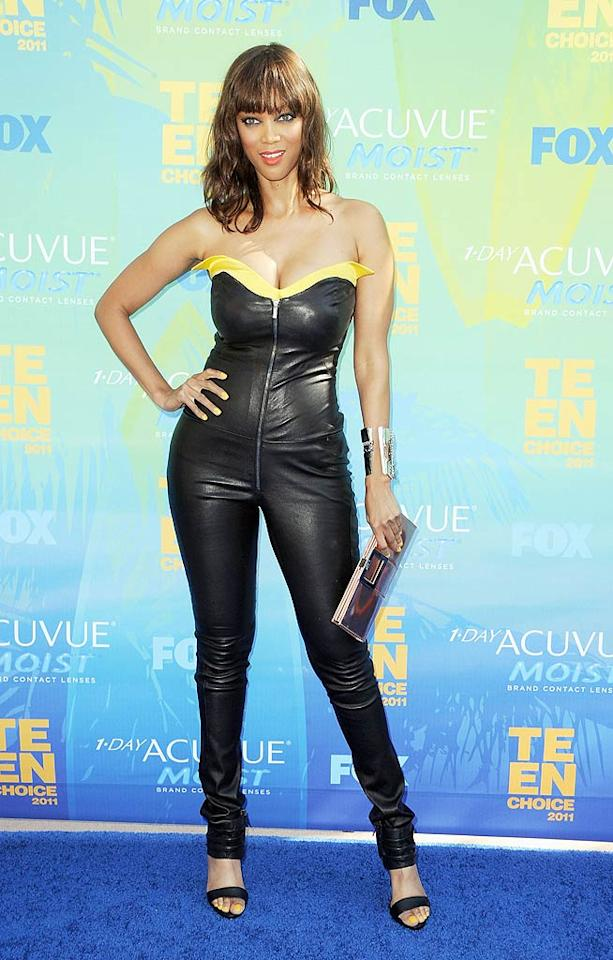 "Tyra Banks attempted to strut her stuff in a rather inappropriate skintight jumpsuit upon arriving at the 2011 Teen Choice Awards held at the Universal Amphitheatre in Los Angeles. Who does she think she is ... Catwoman? Steve Granitz/<a href=""http://www.wireimage.com"" target=""new"">WireImage.com</a> - August 7, 2011"