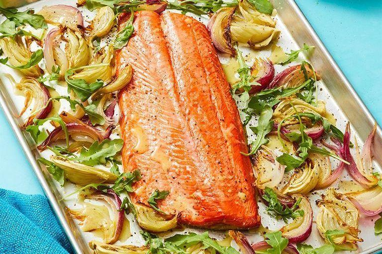 """<p>Give a slight smoky flavor to this easy one-pan dish by charring citrus in your broiler. """"""""In addition to protein, salmon provides the omega-3s EPA and DHA, which are wonderful for <a href=""""https://www.womansday.com/food-recipes/food-drinks/g2176/hearty-healthy-recipes/"""" rel=""""nofollow noopener"""" target=""""_blank"""" data-ylk=""""slk:heart health"""" class=""""link rapid-noclick-resp"""">heart health</a>,"""" Gorin says.<br></p><p><em><a href=""""https://www.womansday.com/food-recipes/food-drinks/a29464781/oven-roasted-salmon-with-charred-lemon-vinaigrette-recipe/"""" rel=""""nofollow noopener"""" target=""""_blank"""" data-ylk=""""slk:Get the Oven-Roasted Salmon with Charred Lemon Vinaigrette recipe."""" class=""""link rapid-noclick-resp"""">Get the Oven-Roasted Salmon with Charred Lemon Vinaigrette recipe.</a></em></p>"""