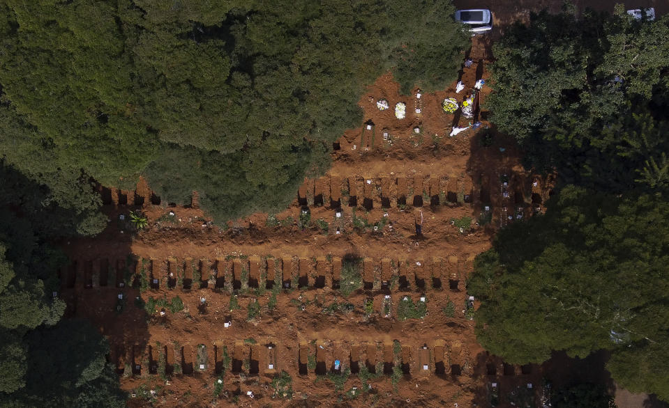 Aerial view of a burial, next to new graves in the Vila Formosa cemetery, due to an expected increase in deaths within the COVID-19 coronavirus pandemic, in the city of Sao Paulo, Brazil, 21 April 2020. (Photo by Miguel SCHINCARIOL / AFP) (Photo by MIGUEL SCHINCARIOL/AFP via Getty Images)