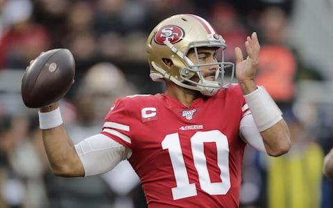 San Francisco 49ers quarterback Jimmy Garoppolo throws against the Green Bay Packers in the first half of their NFC Championship game at Levi's Stadium in Santa Clara, California, USA, 19 January 2020. - Credit: REX
