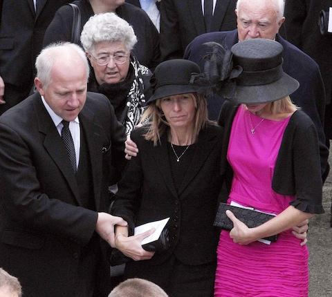 Ellen Williams (centre) at her son's funeral in September 2010 - Credit: Peter Byrne/PA Wire