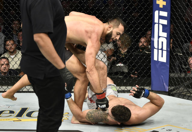 BOSTON, MASSACHUSETTS - OCTOBER 18: (L-R) Dominick Reyes punches Chris Weidman in their light heavyweight bout during the UFC Fight Night event at TD Garden on October 18, 2019 in Boston, Massachusetts. (Photo by Chris Unger/Zuffa LLC via Getty Images)