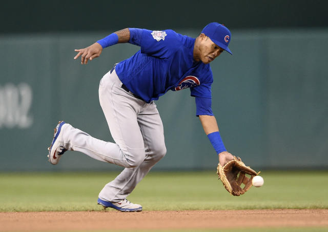 FILE - In this Sept. 8, 2018, file photo, Chicago Cubs shortstop Addison Russell fields a ground ball by Washington Nationals' Anthony Rendon during the fifth inning of the first baseball game of a doubleheader, Saturday, Sept. 8, 2018, in Washington. Russell and the Cubs have agreed to a $3.4 million, one-year contract, a relatively small $200,000 raise for a player whose relationship with the team appeared strained after a domestic violence suspension. (AP Photo/Nick Wass, File)
