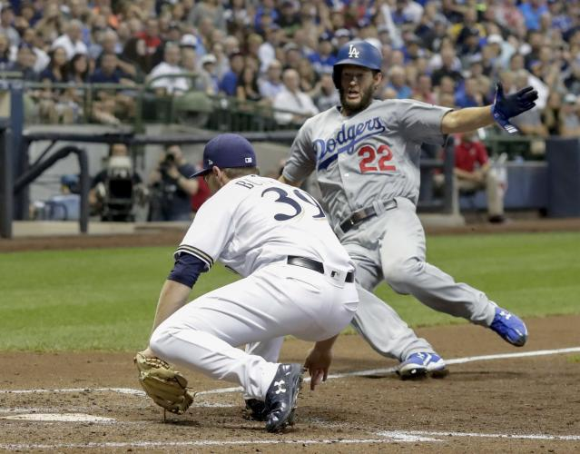Milwaukee Brewers' Corbin Burnes tags out Los Angeles Dodgers' Clayton Kershaw during the fifth inning of a baseball game Saturday, July 21, 2018, in Milwaukee. Kershaw tried to score from third on a pitch that got passed catcher Erik Kratz. (AP Photo/Morry Gash)