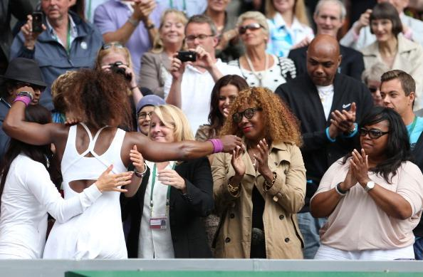 Serena Williams of the USA celebrates with her mother Oracene Price and her team after her Ladies' Singles final match against Agnieszka Radwanska of Poland on day twelve of the Wimbledon Lawn Tennis Championships at the All England Lawn Tennis and Croquet Club on July 7, 2012 in London, England. (Photo by Julian Finney/Getty Images)