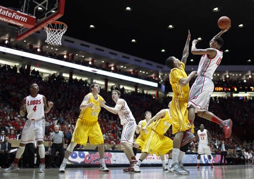 New Mexico's Kendall Williams, right, shoots over Valparaiso's Chris Perez during the first half of an NCAA college basketball game at University Arena in Albuquerque, N.M., Saturday, Dec. 8, 2012. (AP Photo/Craig Fritz)