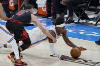 Oklahoma City Thunder forward Luguentz Dort, right, dives for a ball in front of Chicago Bulls' Zach LaVine (8) during the second half of an NBA basketball game Friday, Jan. 15, 2021, in Oklahoma City. (AP Photo/Sue Ogrocki)