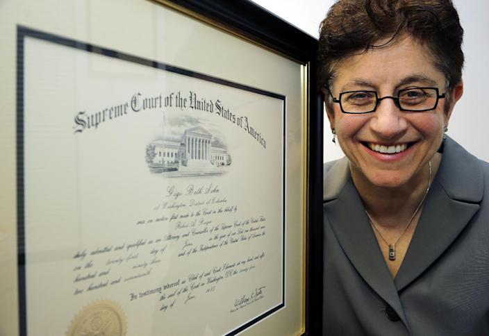 "In this Feb. 13, 2013, photo, Gigi Sohn, poses for a photograph with her certificate that says she is a member of the Supreme Court bar, in Washington. Only a few lawyers will ever get to argue before the U.S. Supreme Court. Every year, however, thousands of lawyers join the Supreme Court bar, the group of lawyers allowed to practice before the nation's highest court. Sohn said she joined the Supreme Court bar in 1993 because it seemed like fun. The membership fee has turned out to be the ""best $200 I've ever spent,"" she said, ""because I've gotten access to top cases."" (AP Photo/Alex Brandon)"