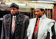 <ul> <li><strong>What to wear for Akeem:</strong> There are so many looks you can channel from this movie, but the Prince's look upon arriving to America is among the best. Grab a faux fur and matching hat, with a suit and red tie underneath. Don't forget the black leather gloves.</li> <li><strong>What to wear for Semmi:</strong> A black coat and matching hat, plus a suit with a patterned tie, is all you need. Make sure everything is oversized!</li> </ul>