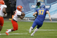 Sam Houston State wide receiver Jequez Ezzard (12) runs for a touchdown as South Dakota State defensive end Reece Winkelman (97) chases him during the first half of the NCAA college FCS Football Championship in Frisco, Texas, Sunday, May 16, 2021. (AP Photo/Michael Ainsworth)