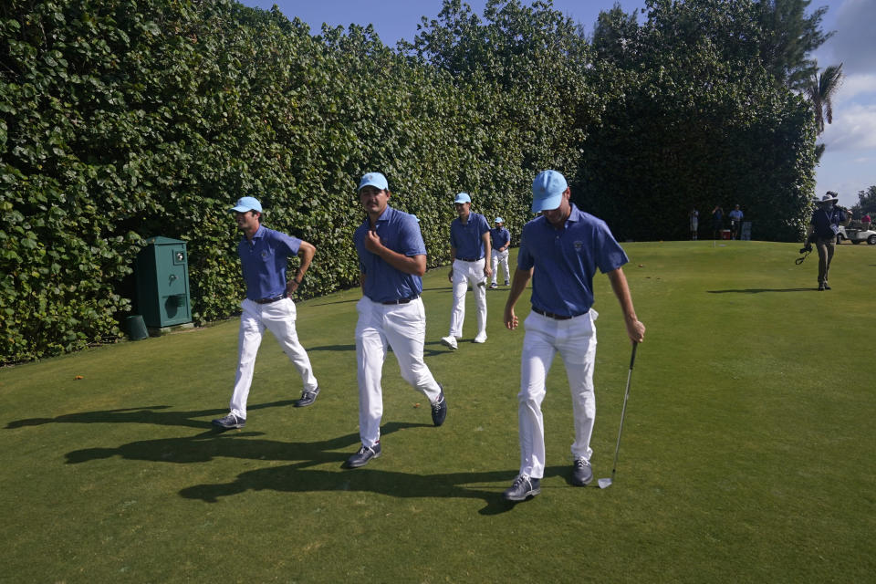 Members of the USA team walk along the course during a practice day for the Walker Cup golf tournament at Seminole Golf Club in Juno Beach, Fla., Friday, May 7, 2021. (AP Photo/Gerald Herbert)