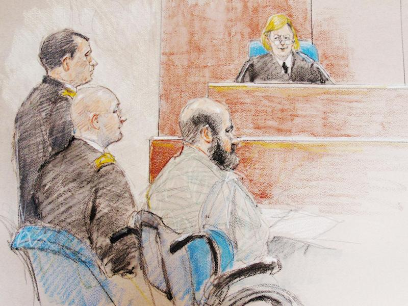 In this courtroom sketch, U.S. Army Maj. Nidal Hasan, right, sits by his former defense attorneys Maj. Joseph Marcee, far left, and Lt. Col. Kris Poppe, center, during a hearing at Fort Hood, Texas, Tuesday, June 11, 2013. The judge, Col. Tara Osborn, has delayed a ruling on whether to allow Hasan's defense strategy, and his trial date has not been set. (AP Photo/Brigitte Woosley)