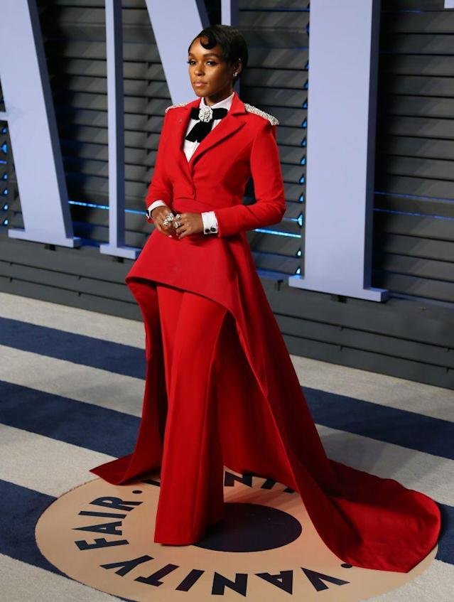 <p>The singer and actress modeled a bright red Christian Siriano suit. (Photo: JEAN-BAPTISTE LACROIX/AFP/Getty Images) </p>