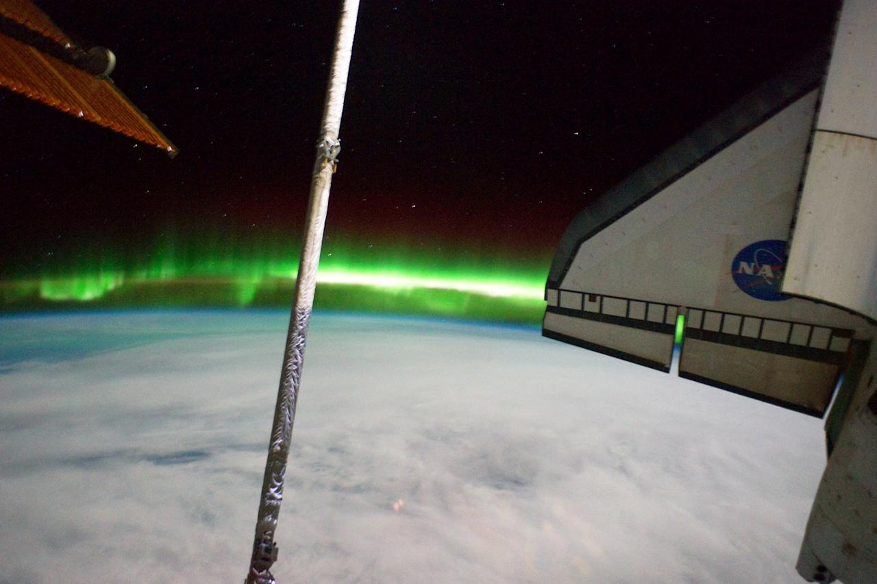 IN SPACE - JULY 14:  In this handout image provided by the National Aeronautics and Space Administration (NASA), the Southern Lights or Aurora Australis and the port side wing of NASA space shuttle Atlantis (R) can be seen from the International Space Station July 14, 2011 in space. Space shuttle Atlantis is on the last leg of a 12-day mission to the International Space Station where it delivered the Raffaello multi-purpose logistics module packed with supplies and spare parts. This was the final mission of the space shuttle program, which began on April 12, 1981 with the launch of Colombia.  (Photo by NASA via Getty Images)