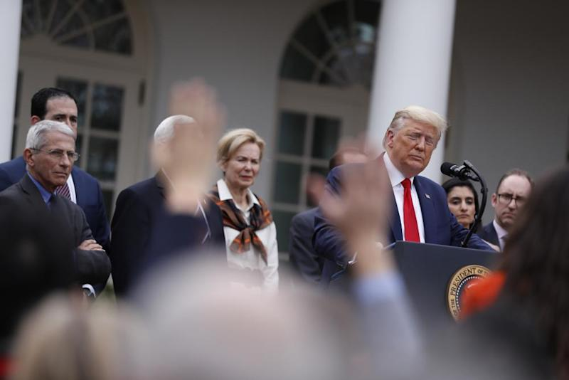U.S. President Donald Trump takes a question from a member of the media during a news conference in the Rose Garden of the White House in Washington, D.C., U.S., on Friday, March 13, 2020. Trump declared a national emergency over the coronavirus outbreak to allow for more federal aid for states and municipalities.