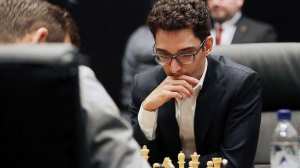 PHOTO: Italian-American challenger Fabiano Caruana plays reigning chess world champion Magnus Carlsen, left, from Norway, in the first few minutes of round 12 of their World Chess Championship Match in London, Nov. 26, 2018. (Matt Dunham/AP)