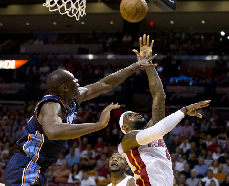 Charlotte Bobcats' Bismack Biyombo (0) blocks Miami Heat's LeBron James (6) during the first half of an NBA basketball game in Miami, Sunday, March 24, 2013. (AP Photo/J Pat Carter)