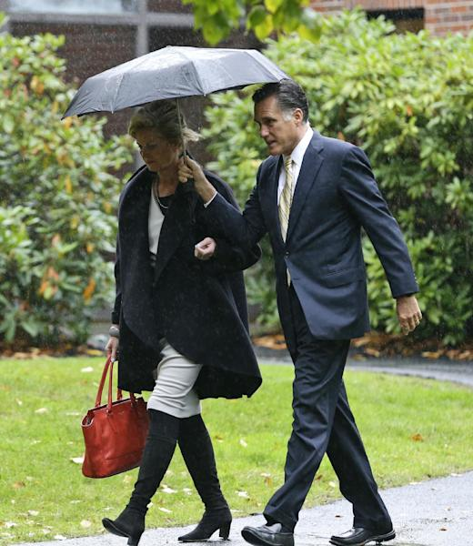 Republican presidential candidate and former Massachusetts Gov. Mitt Romney walks with wife Ann as they leaves the Church of Jesus Christ of Latter-day Saints in Belmont, Mass., Sunday, Oct. 14, 2012. (AP Photo/Charles Dharapak)
