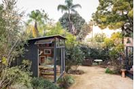 """<p>Have a freestanding shed or an unused garage? Convert it into a modern home office. Going from the main house to your backyard will help replicate the change in environment and headspace you get from a commute. <a href=""""https://www.reathdesign.com/"""" rel=""""nofollow noopener"""" target=""""_blank"""" data-ylk=""""slk:Reath Design"""" class=""""link rapid-noclick-resp"""">Reath Design</a> painted this one black for an inky, eye-catching impact, which is balanced with the understated wall of windows. </p>"""