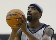 FILE - Memphis Grizzlies center Melvin Ely shoots free throws during NBA basketball training camp at Vanderbilt University in Nashville, Tenn., in this Wednesday, Oct. 2, 2013, file photo. Eighteen former NBA players, including Ely, have been arrested on charges alleging they defrauded the league's health and welfare benefit plan out of about $4 million, according to an indictment Thursday, Oct. 7, 2021. (AP Photo/Mark Zaleski, File)