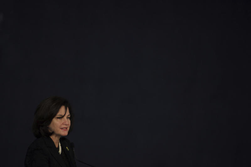 Newly appointed Attorney General Raquel Dodge attends her inauguration ceremony at the Attorney General office in Brasilia, Brazil, Monday, Sept. 18, 2017. Dodge replaces Rodrigo Janot, who last week charged President Michel Temer with leading a criminal organization and obstruction of justice. In July he formally accused the president of corruption. (AP Photo/Eraldo Peres)