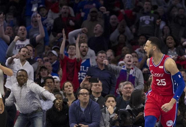 Philadelphia's Ben Simmons, reacting after a dunk as 76ers supporters cheer, is being investigated after talking with the Los Angeles Lakers in hopes of a sit-down chat with team president and NBA legend Magic Johnson (AFP Photo/Mitchell Leff)